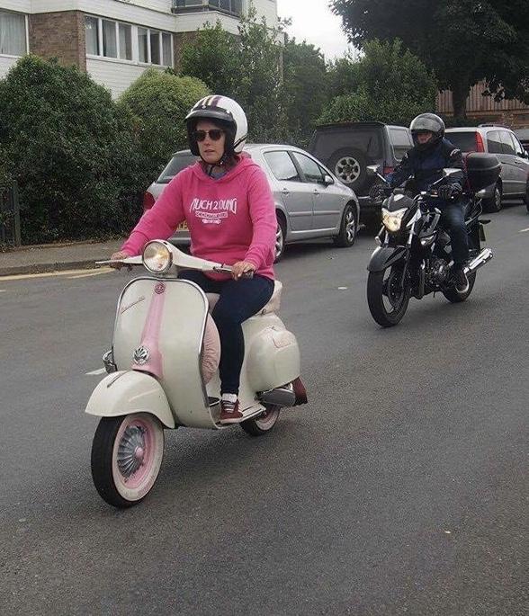 Jen riding her pastel pink Primavera