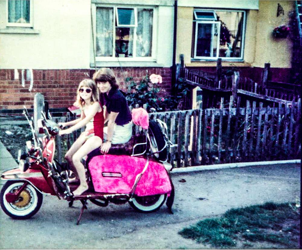 Lambretta scooter with pink furry side panels