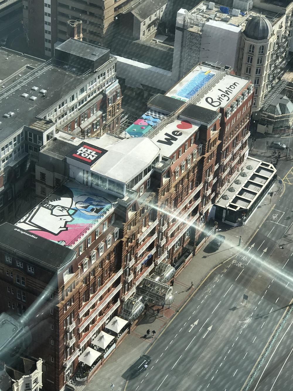 Brighton Hilton hotel with street art on the top. Visible from the i360 attraction which is next to the West Pier!