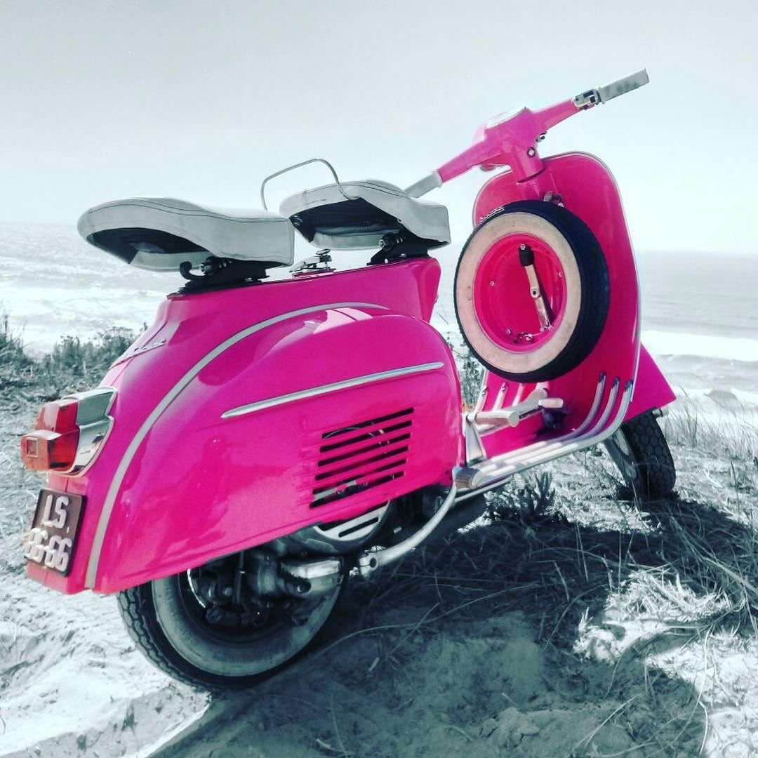 Gorgeous bright pink Vespa scooter