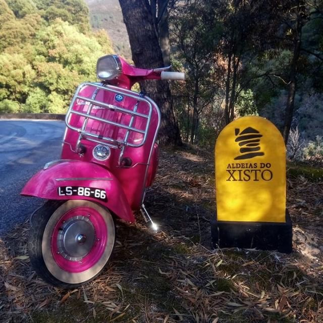 Front view of bright pink Vespa scooter