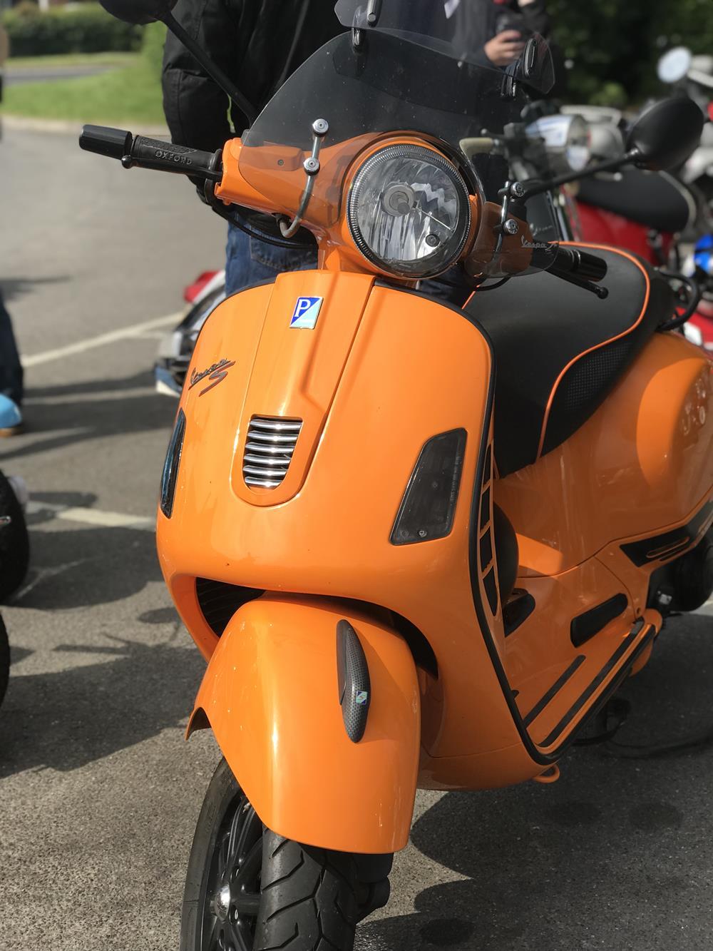 Orange Vespa GTS scooter