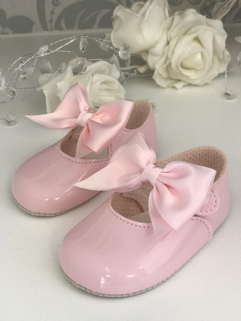 Pink shoes with bows on the top from Betsy Bootique in Bognor