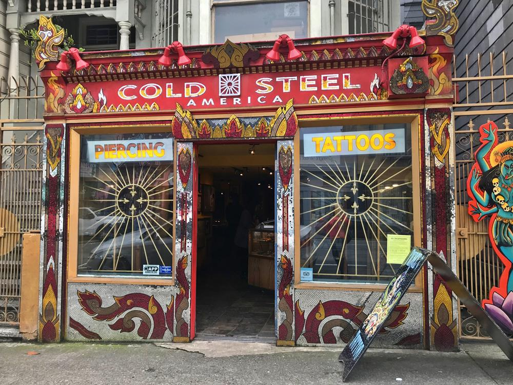 Store front of Cold Steel America, decorated in red and gold mosaic tiles, in the Haight Ashbury district of San Francisco