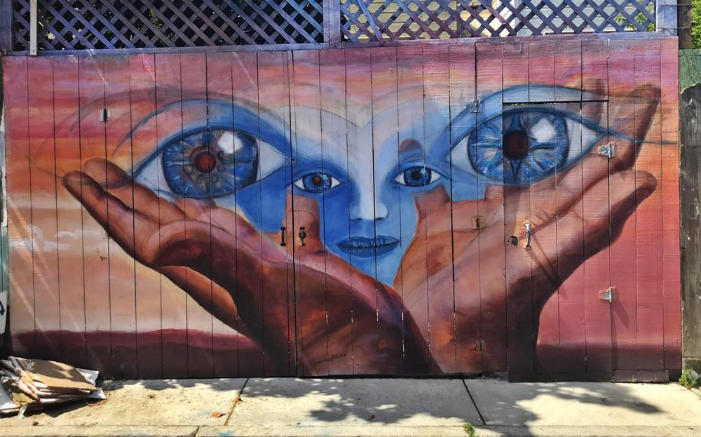 Street art featuring hands and eyes in Balmy Alley