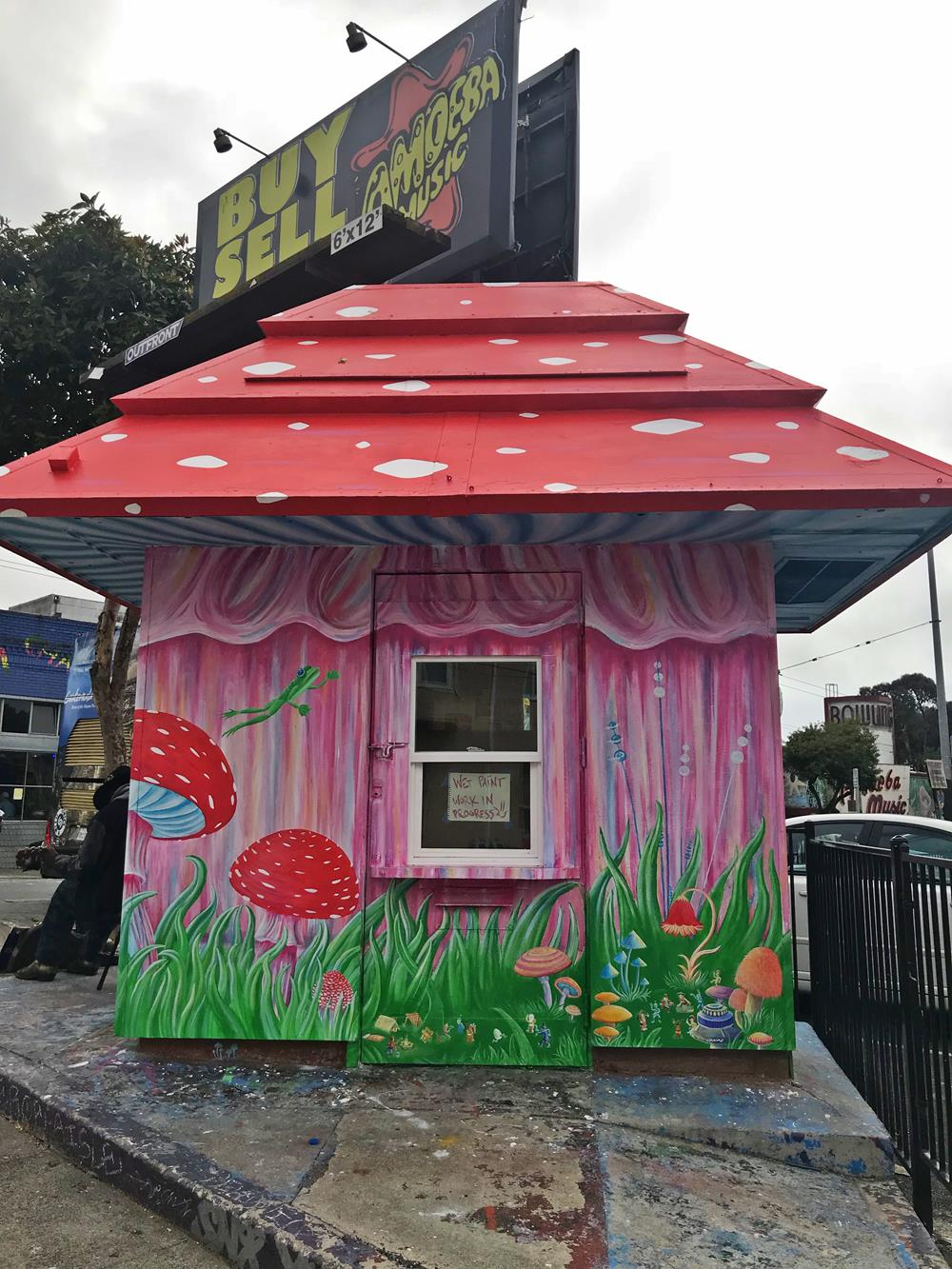 Pink and red kiosk on Haight and Shrader featuring painted wildlife and titled Mushroom With A View
