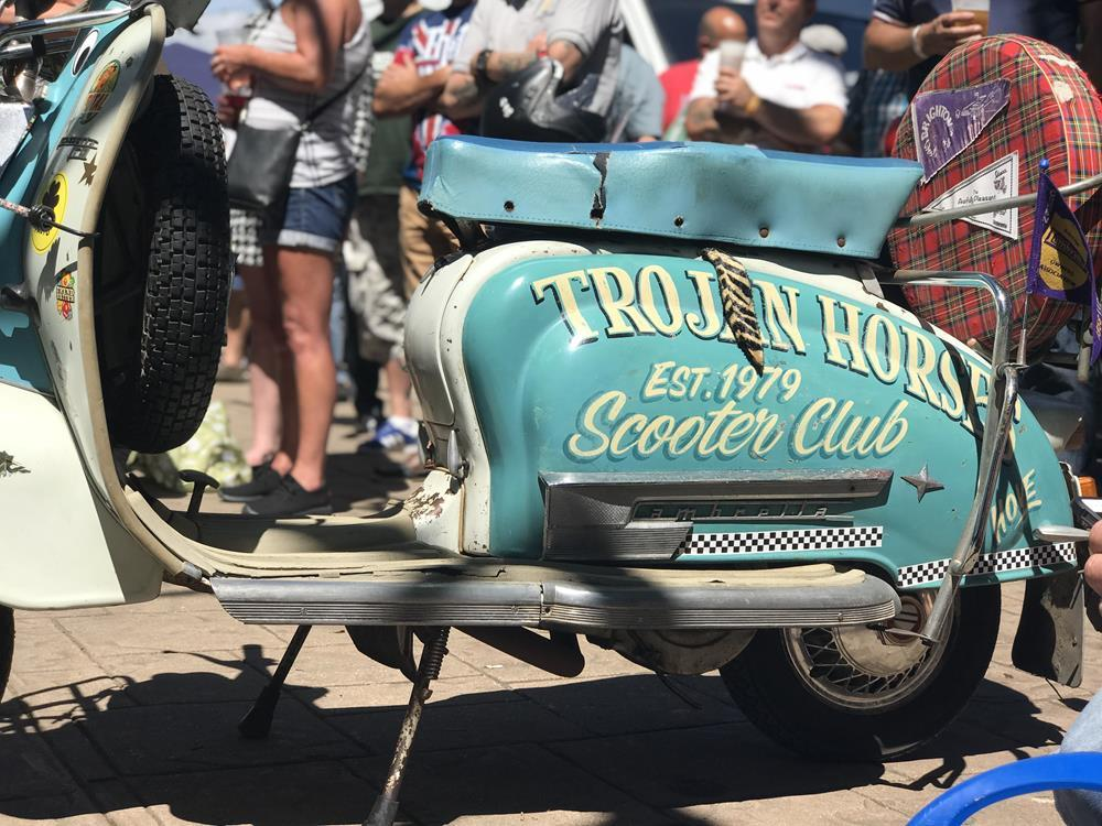 Trojan Horses Scooter Club sign writing on a Lambretta side panel