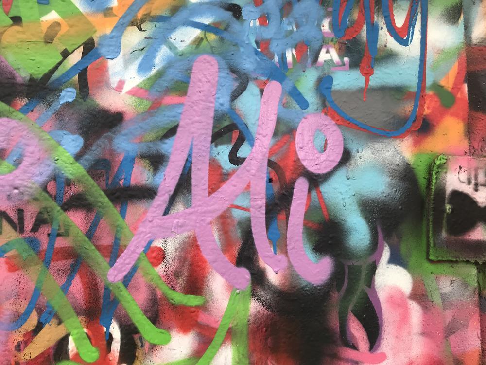 Tag of Ali on graffiti board