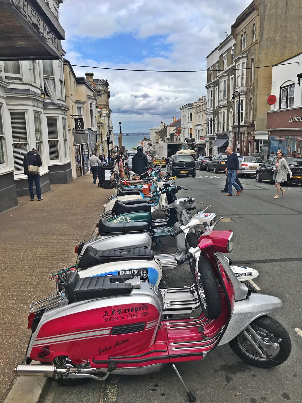 View down Union Street in Ryde with a pink Arthur Francis Lambretta in the foreground