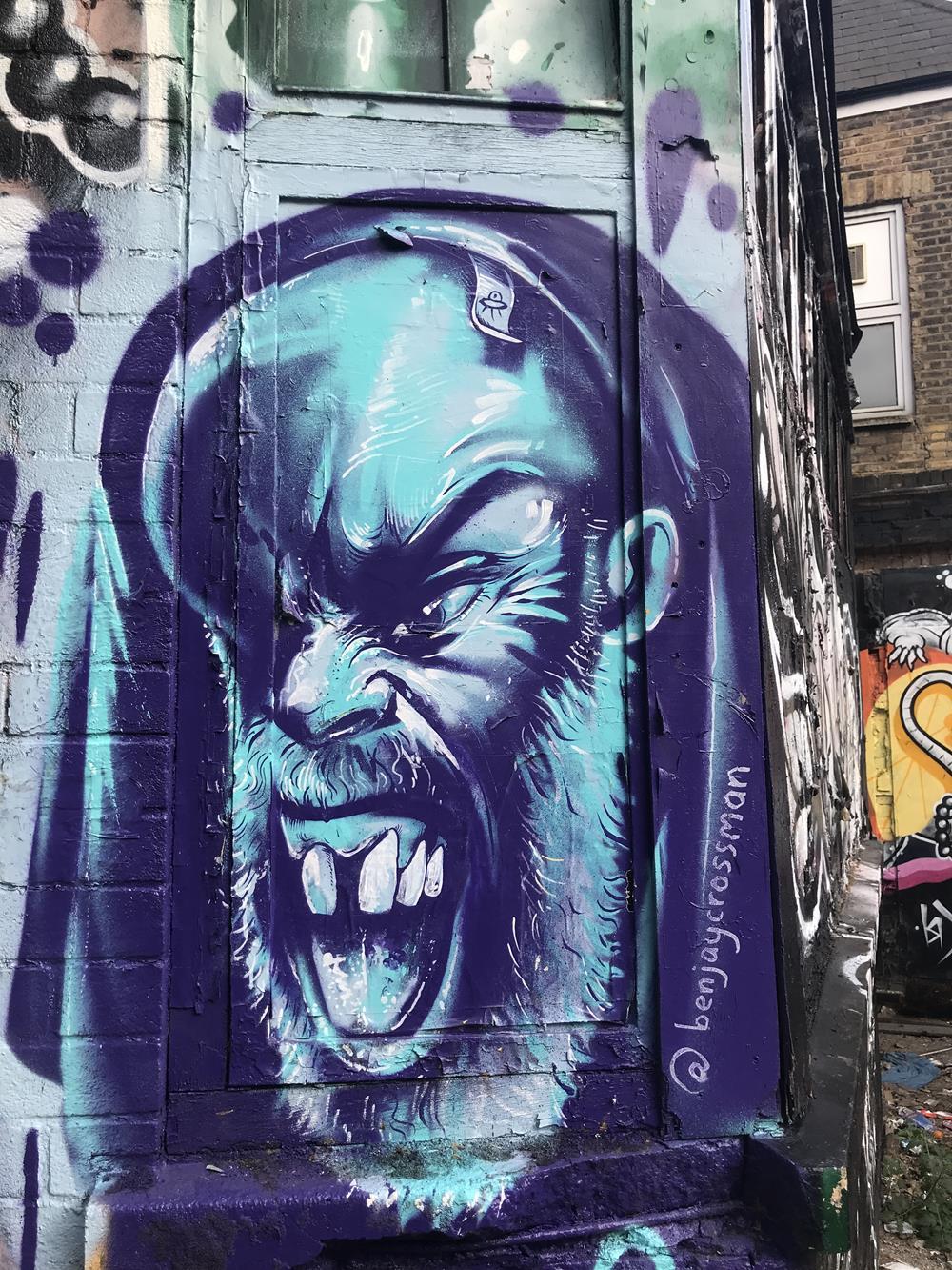 Wall mural by Benjaycrossman in Brick Lane