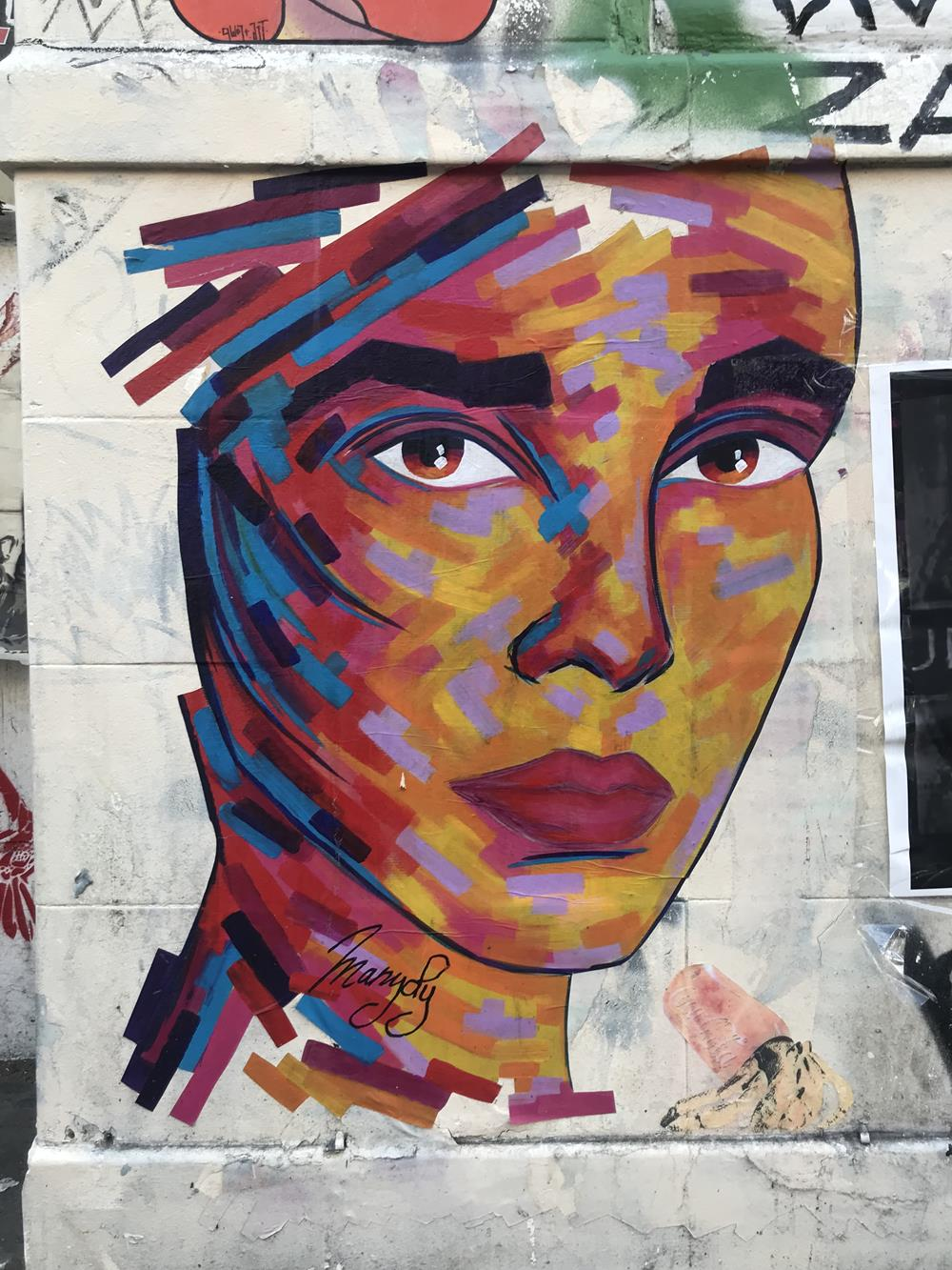 Image of a woman's face depicted in street art