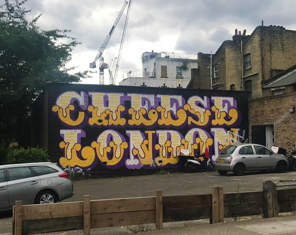 Lettering spelling out Cheese London by Ben Eine