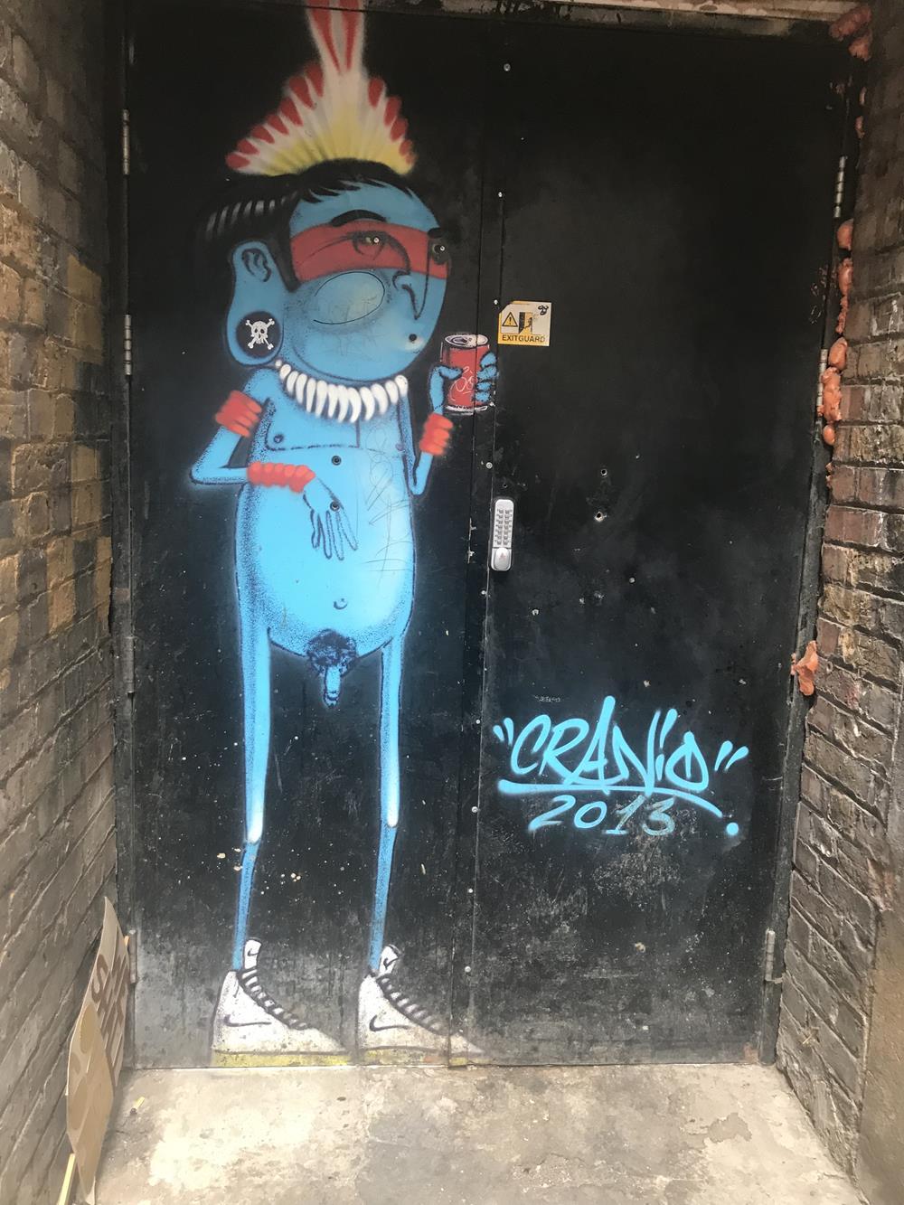 Blue man street art by Cranio