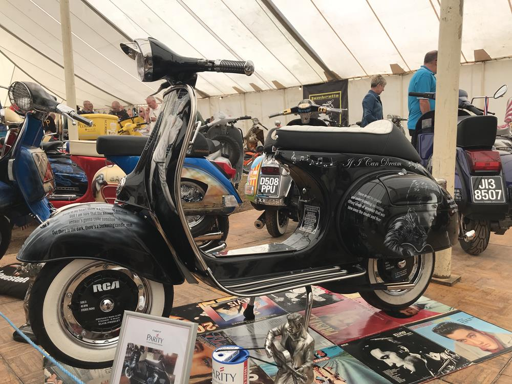 Black Vespa with an Elvis Presley theme and display