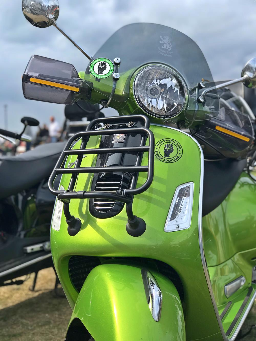 Lime green Vespa GTS with flyscreen