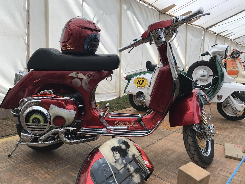 Red custom Vespa with Motown themed murals of various soul stars
