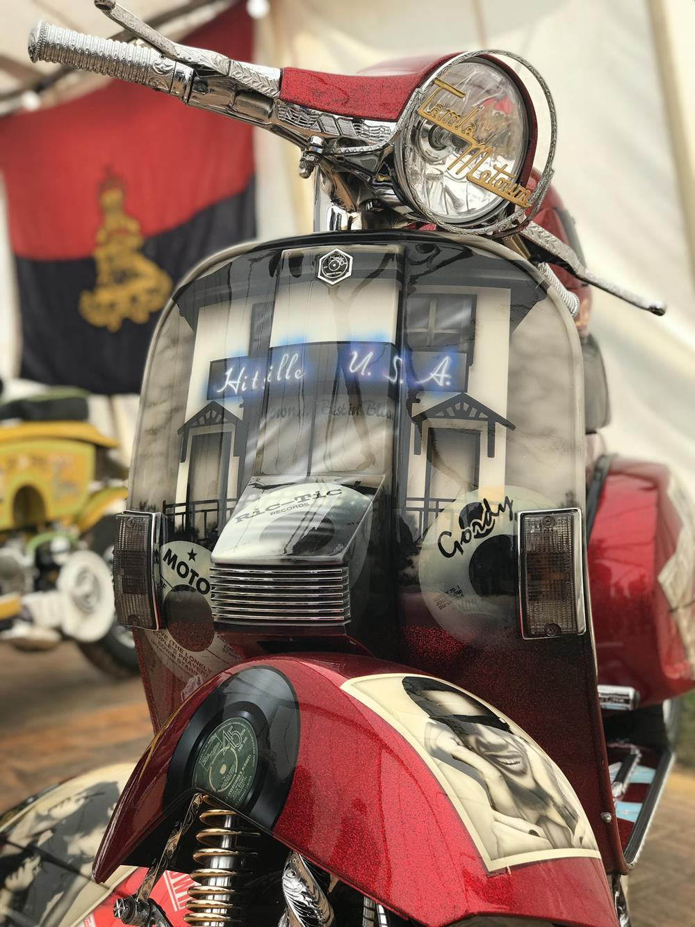 Front legshields on custom Vespa with murals of the front of the Motown building with Hitsville USA on a sign above the door