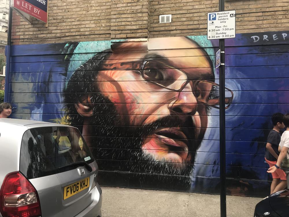 Wall mural of a man's face in Hoxton, London