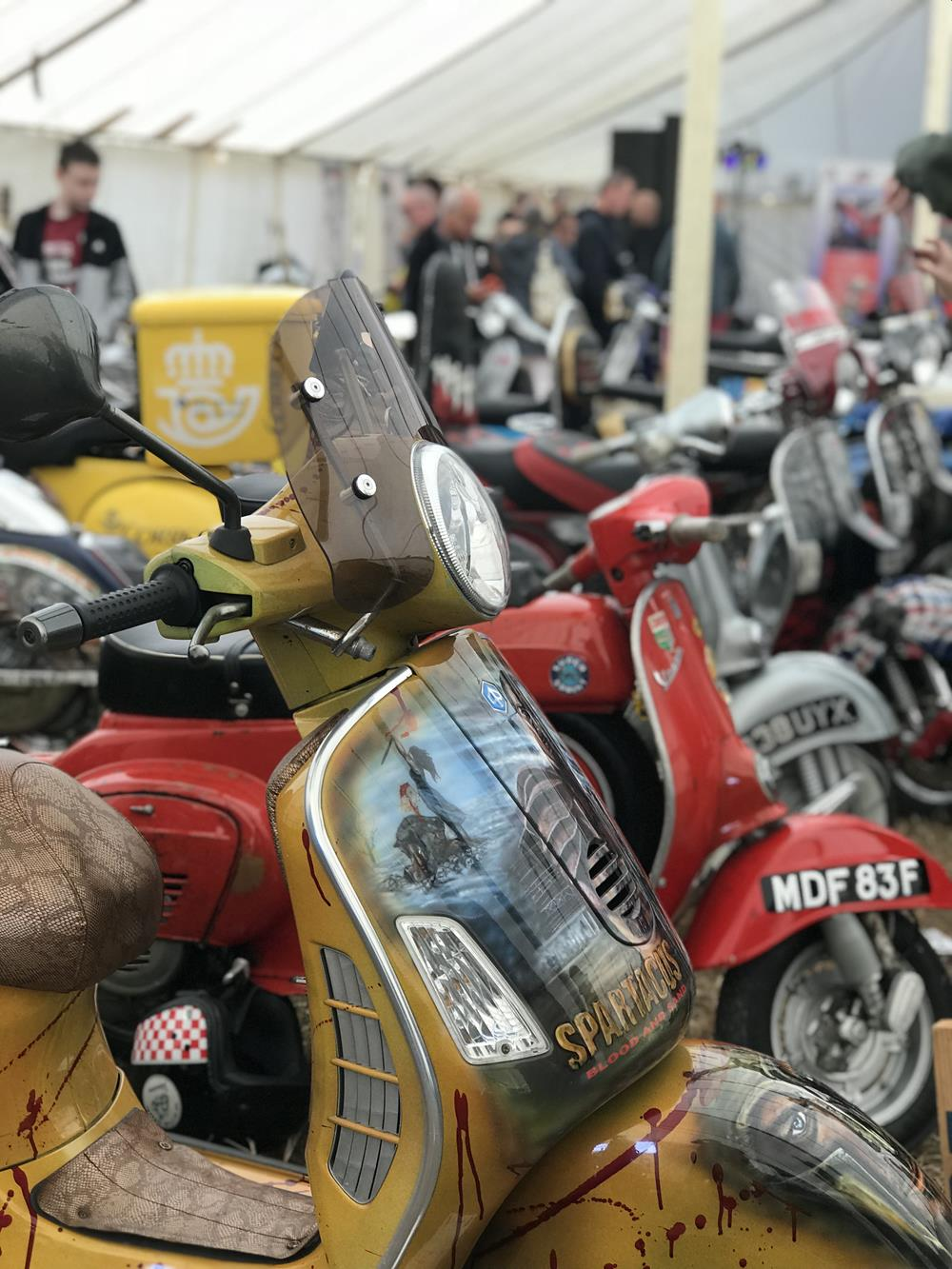 Row of scooters at the Isle of Wight custom show, with Spartacus in the foreground