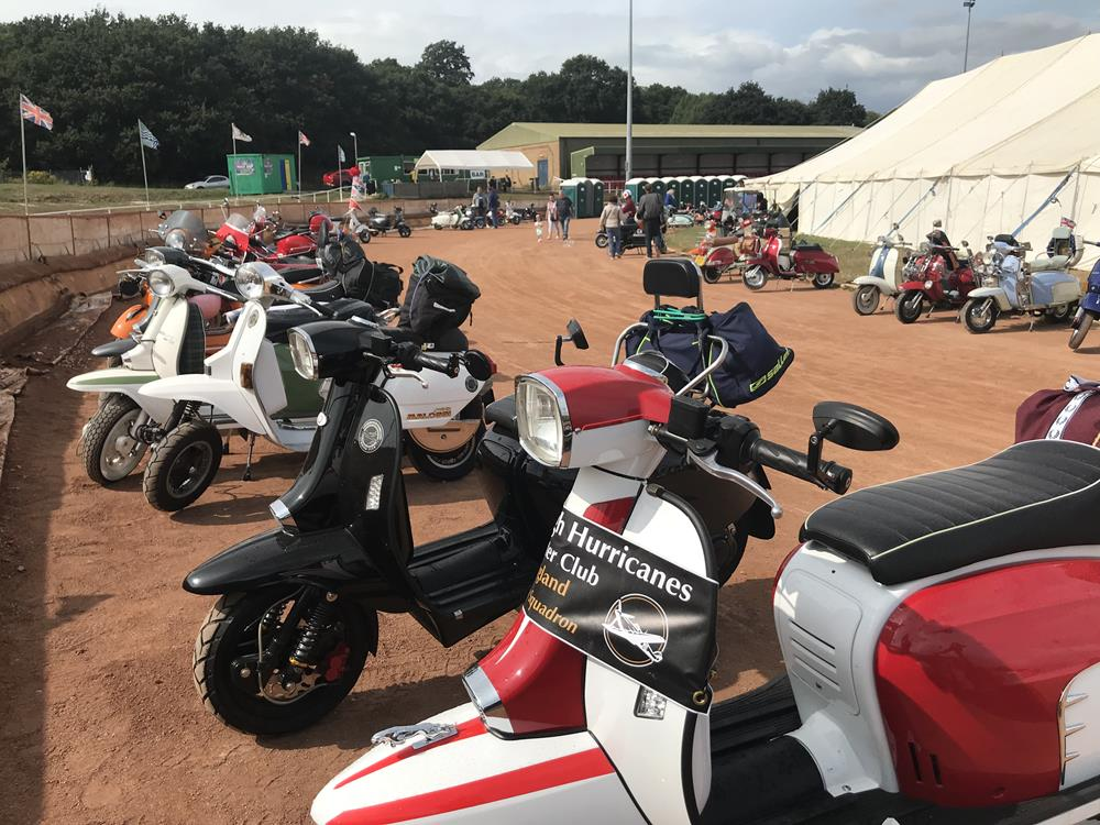 Scooters parked on the racetrack at Smallbrook Stadium
