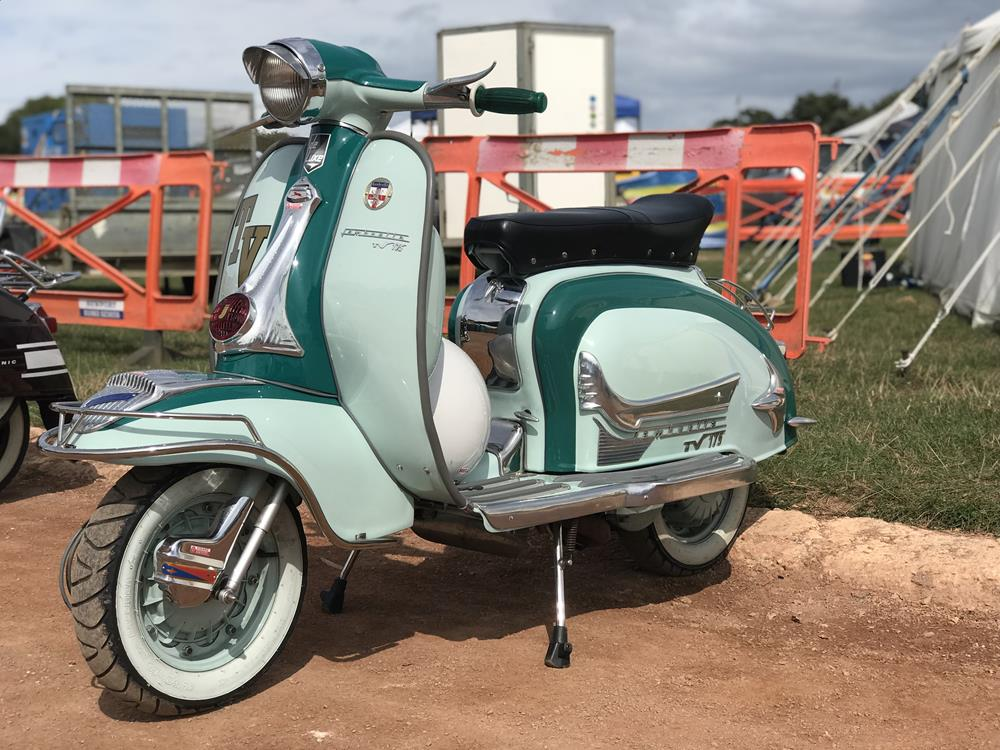 Side view of green Lambretta LI scooter at Smallbrook Stadium, Ryde, at the Isle of Wight scooter rally in 2018