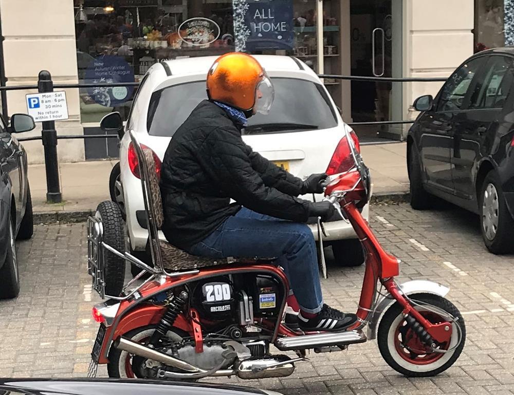 Scooterist riding a Lambretta