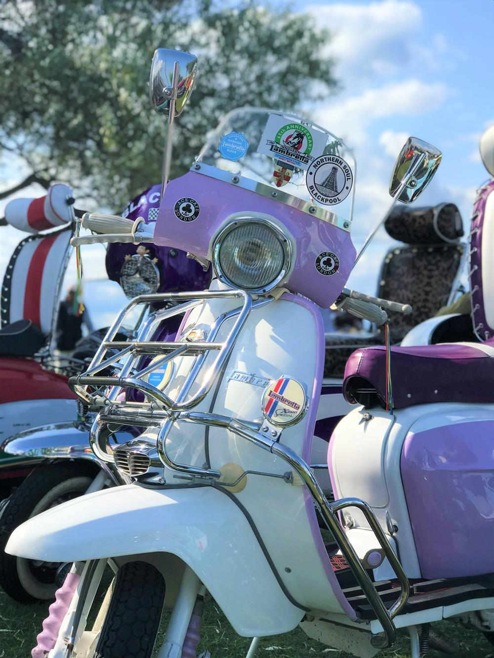 Lilac and white Lambretta with flyscreen