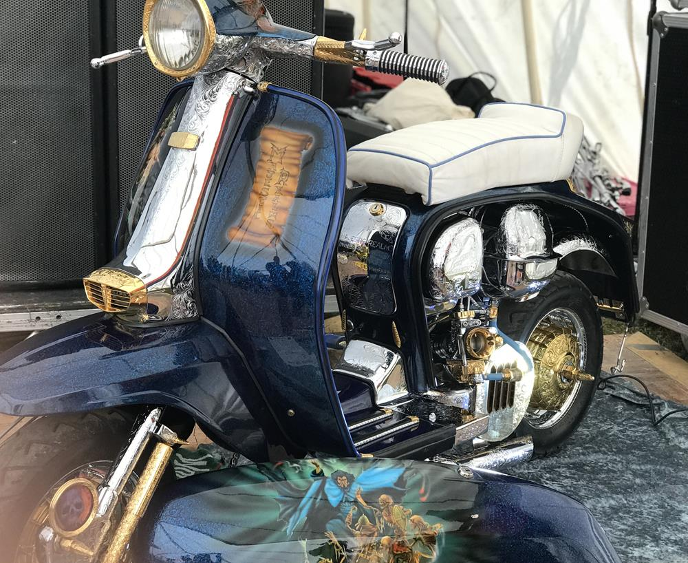 Majestic Realms custom Lambretta with engraved engine, horncasting and fantasy murals.