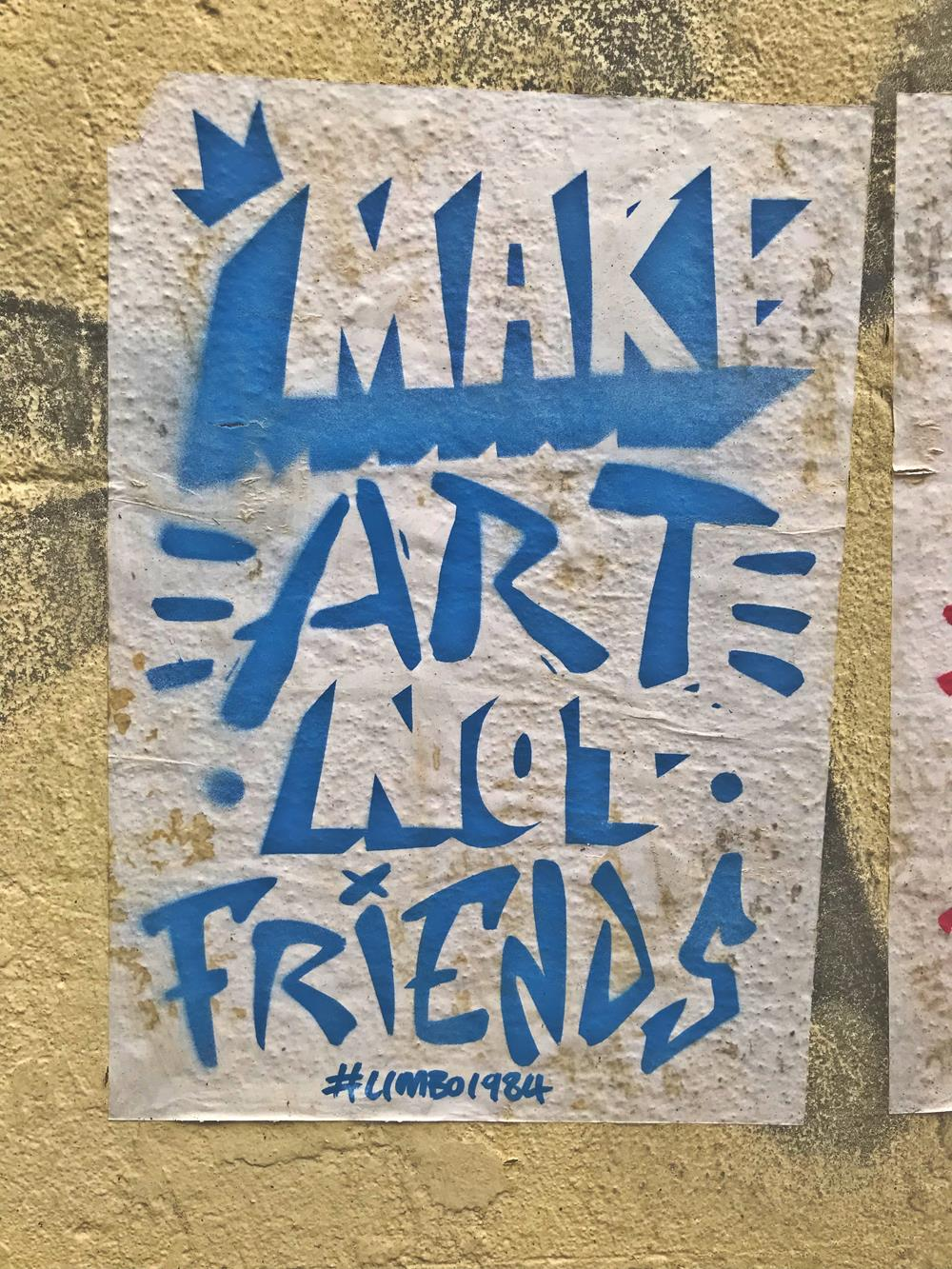 Make art not friends blue text on a white background paste-up
