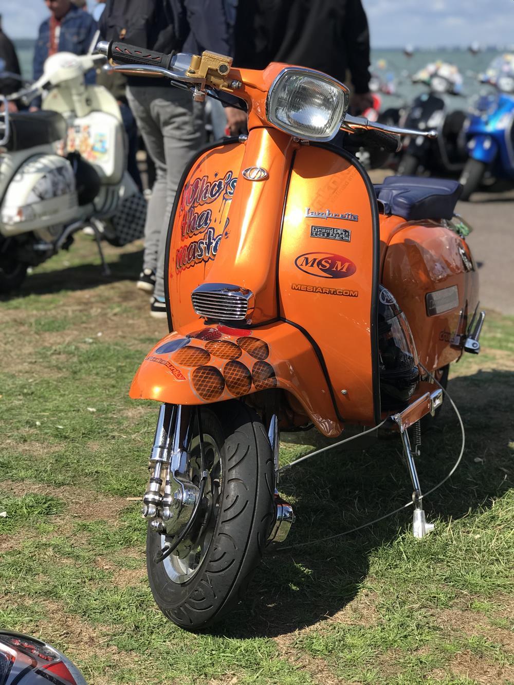 Orange Lambretta scooter