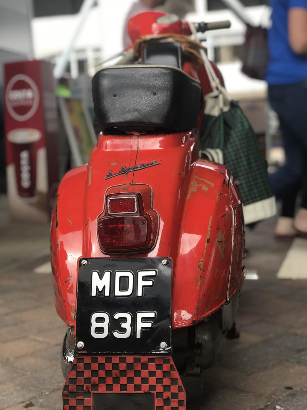 Rear view of red Vespa Super Sprint