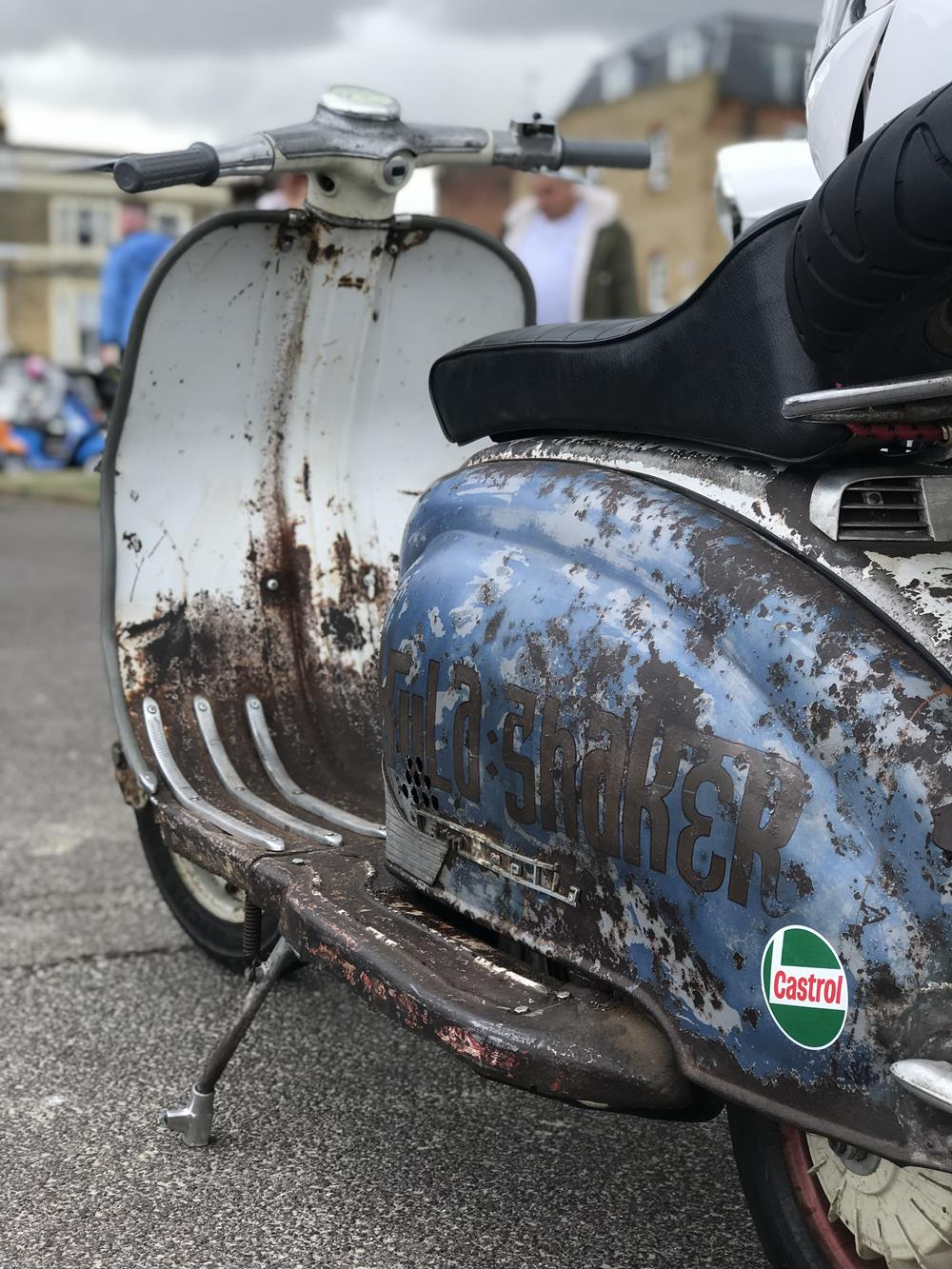 Rusty Lambretta with blue rusty side panel