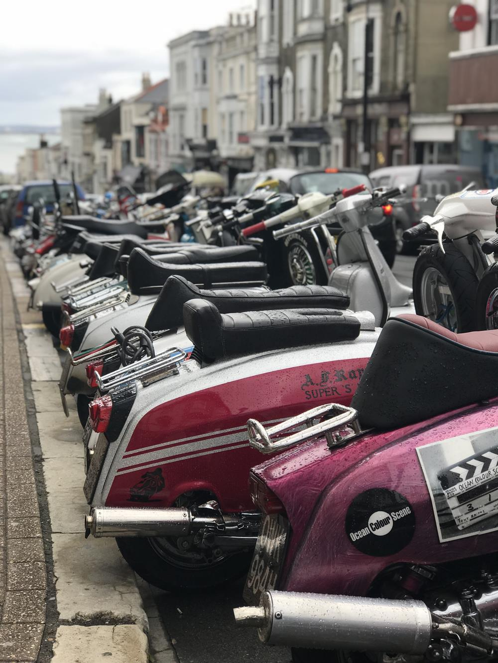 View of Union Street with rear ends of Lambrettas in the foreground