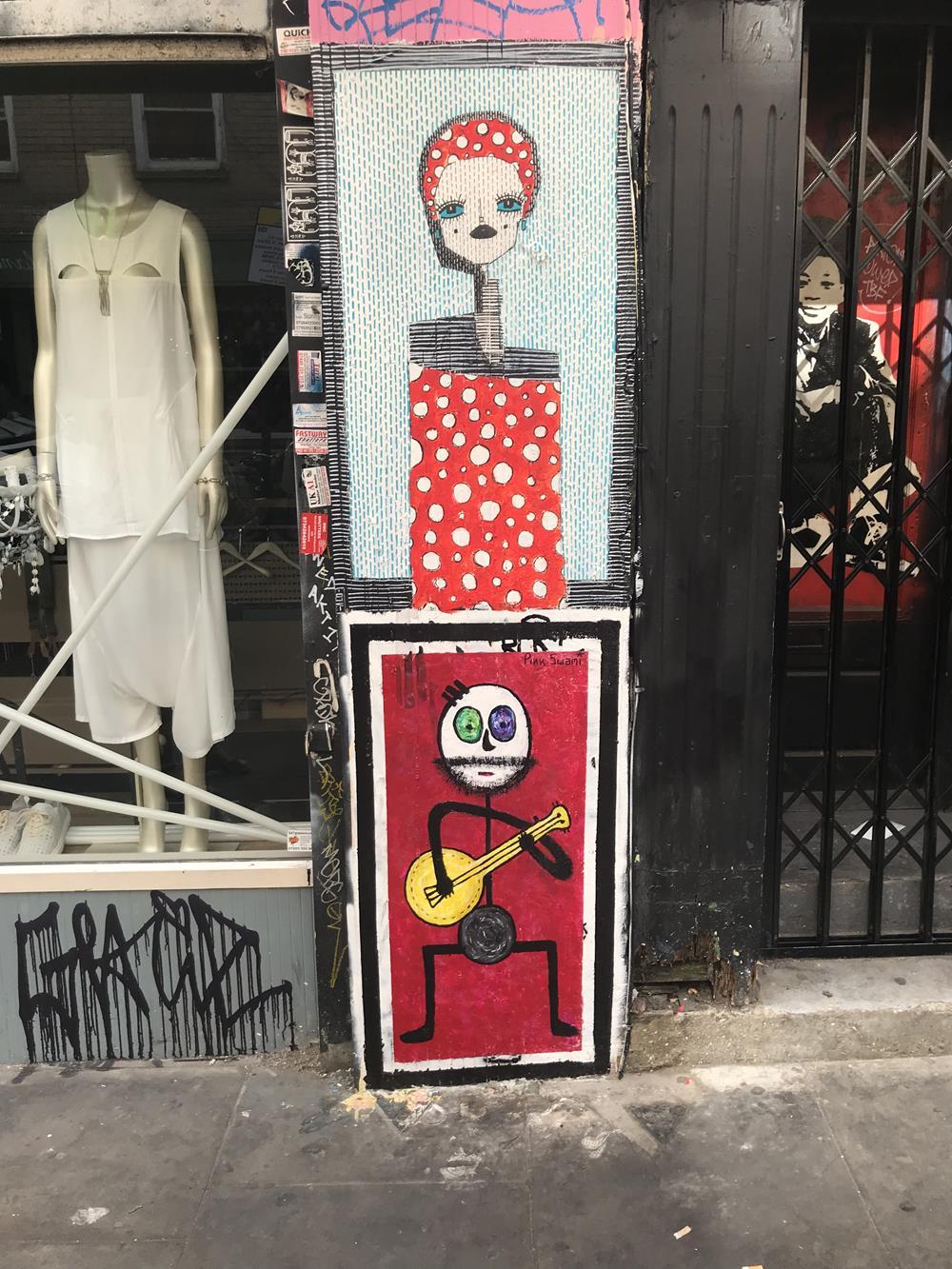 Paste-up street art in Shoreditch