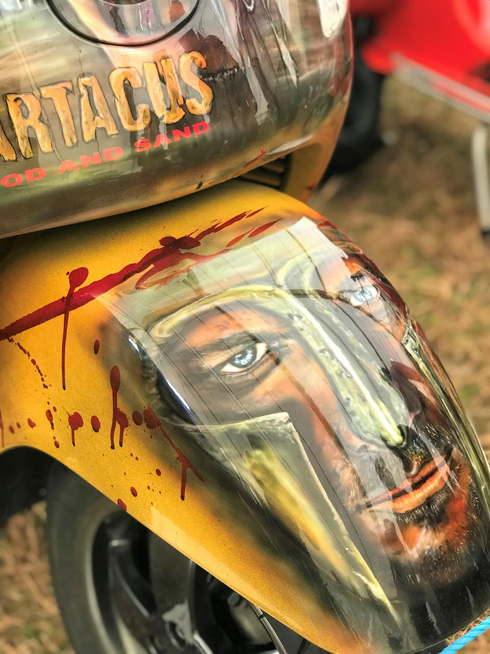 Front mudguard with Spartacus murals on custom Vespa GTS scooter