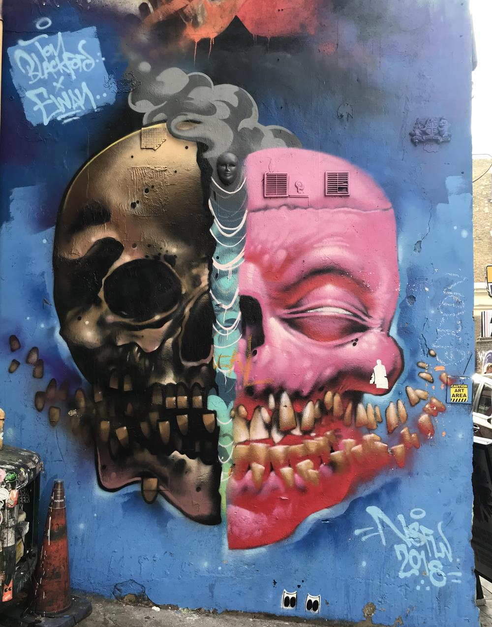 Tom Blackford wall mural of skulls