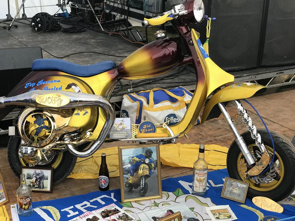 Top Banana custom scooter with pictures, bottles of banana alcoholic drinks and various other items on display