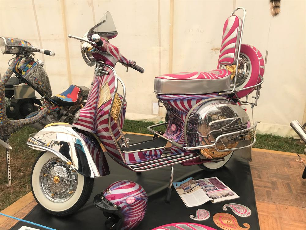 Twisted soul Vespa with chrome panels and mudguard, pink stripy paintwork and accessories