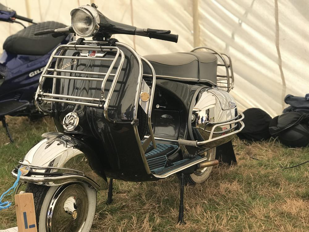 Vespa GS with black paintwork and chrome mudguard and panels