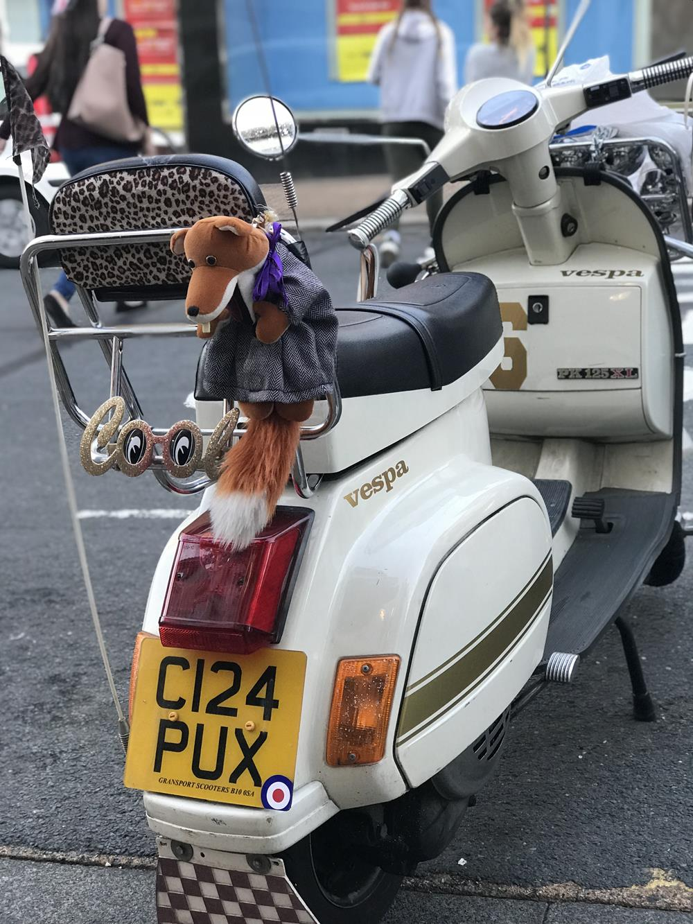 Vespa PK with Basil Brush tied to the backrest