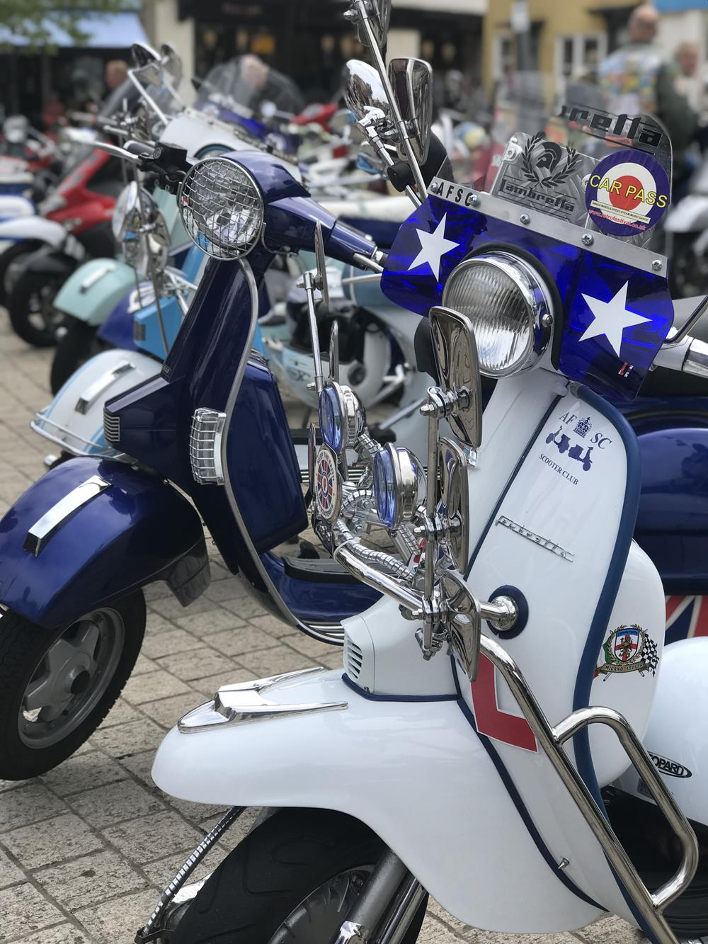 White mod-style Lambretta with flyscreen and crashbars