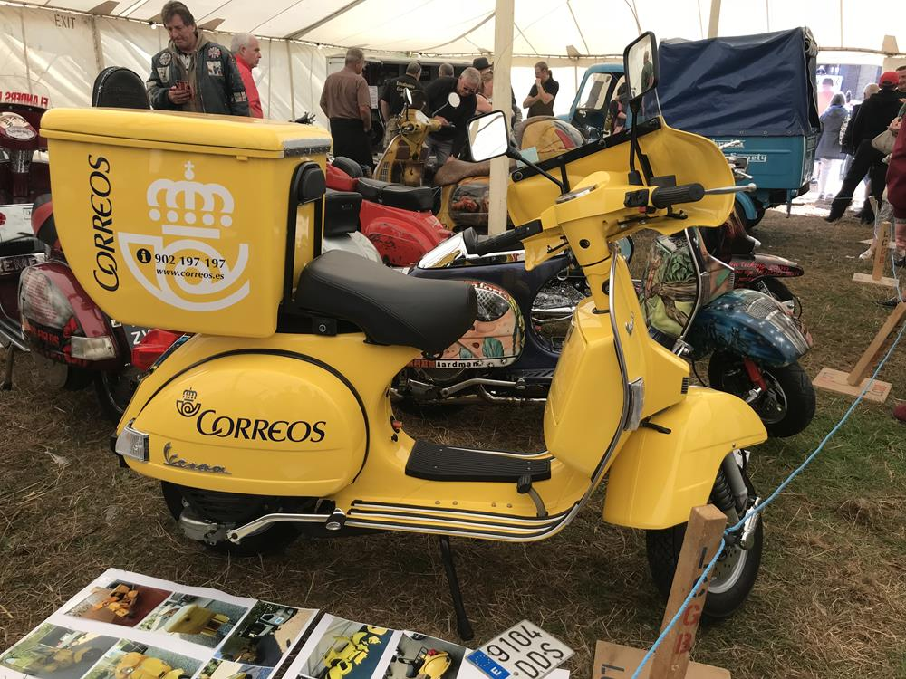 Yellow Correos delivery Vespa scooter on display at the Isle of Wight custom show