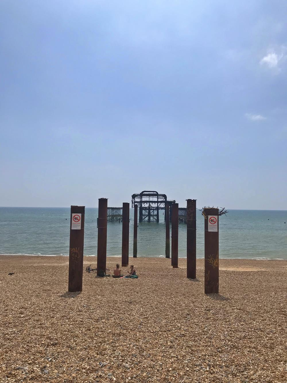 View of the West Pier nestled between steel walkway supports
