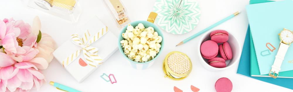 Popcorn, macaroons and stationery in a pretty pink and aqua theme
