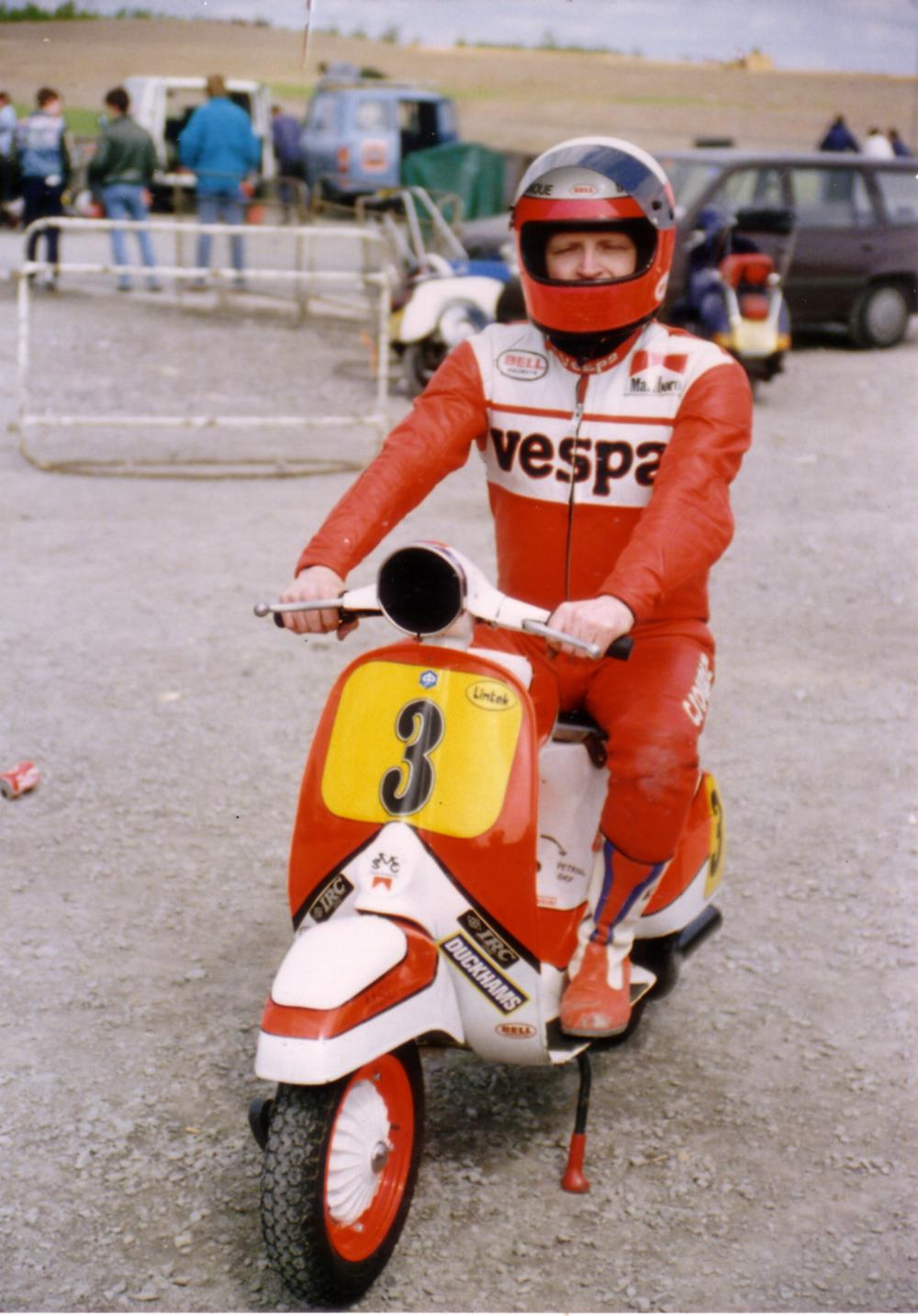 Norrie Kerr in racing leathers on a Vespa racing scooter