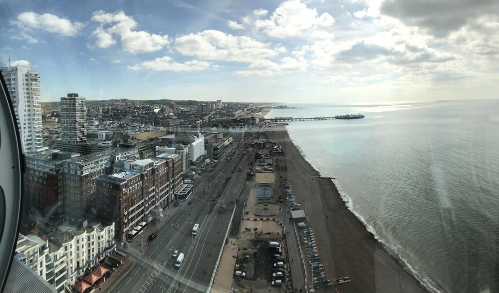 A panoramic view of Brighton seafront and the Palace Pier from the top of the i360