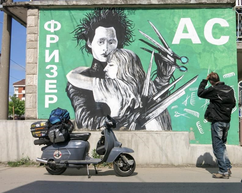 Edward Scissorhands wall mural in Serbia with a Lambretta in the foreground