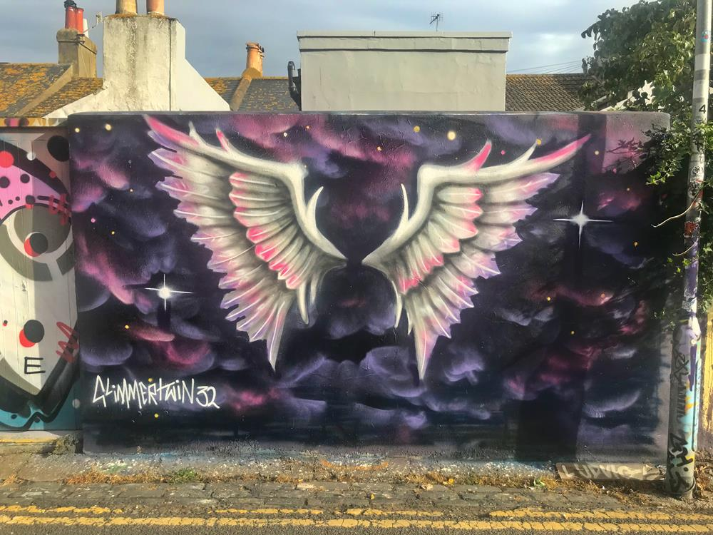 Purple, white and pink angel wings in Trafalgar Lane, Brighton