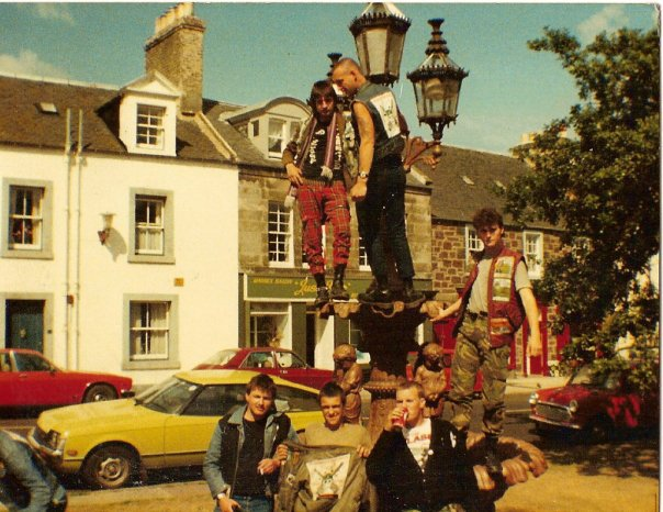 Members of the Midhurst Detours on a monument in the 1980s