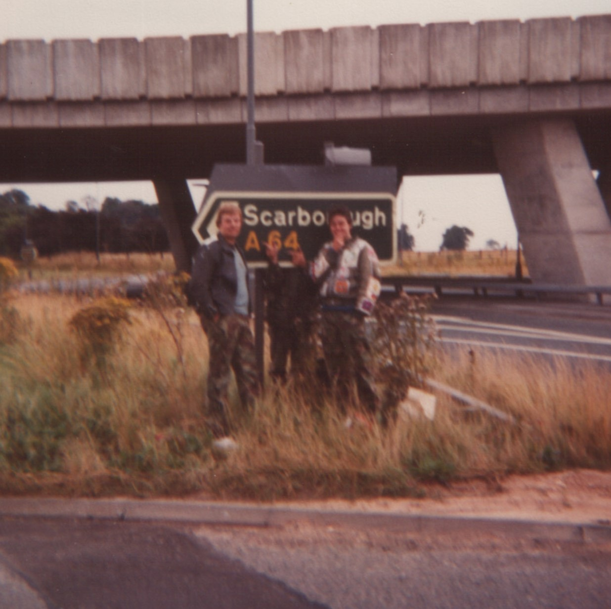 Dizzy and the Midhurst Detours with a Scarborough sign on the A64